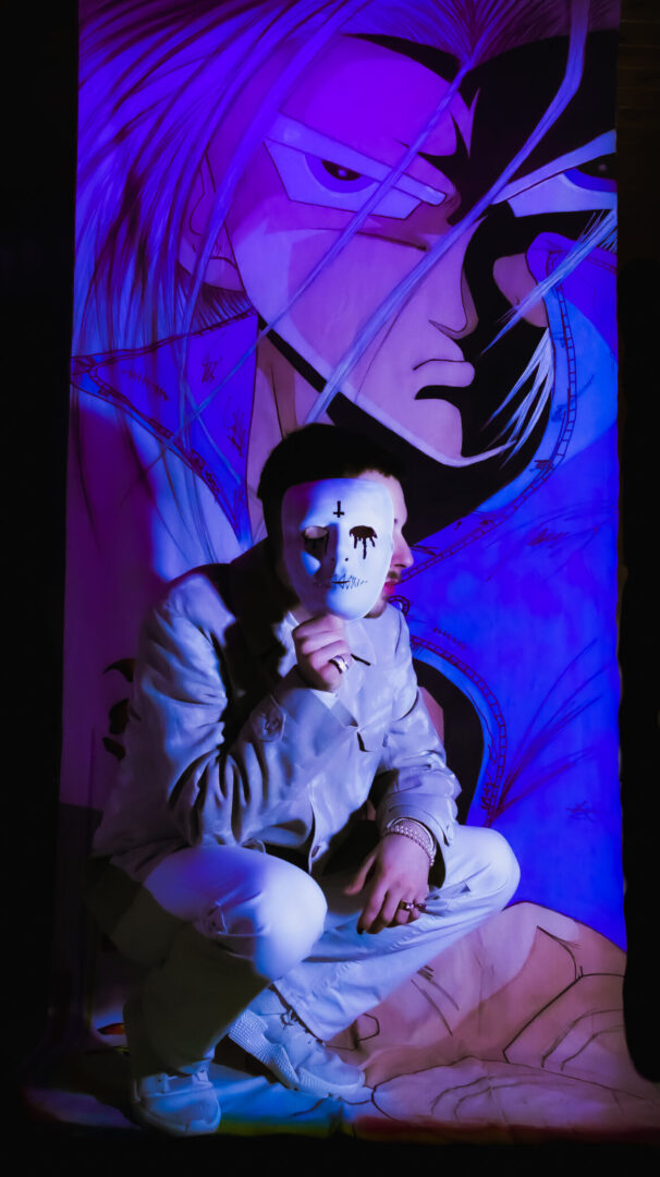 Model posing in front of a chinese Manga character. A UV light illuminating the scene.