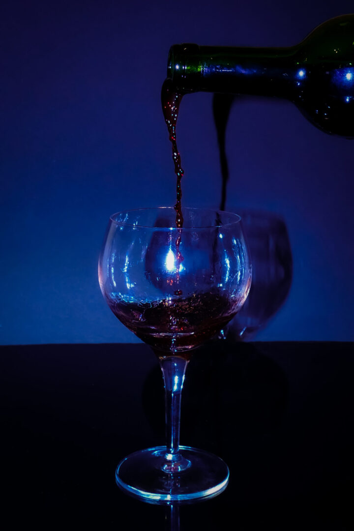 Photo achieved with a fast shutter-speed. Wine beeing poured into a wine glass.